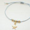 Zartes Armband mit goldenem Stern in verschiedenen Farben