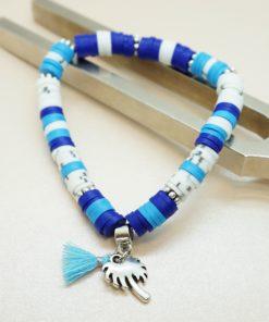 Perlen-Armband mit silberner Palme und bunten Katsuki-Perlen.